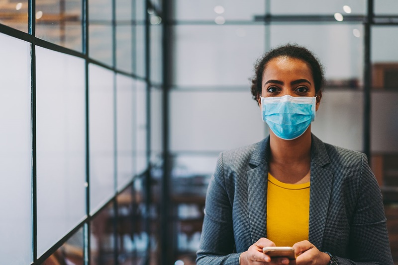 Businesswoman wearing protective face mask in the office during COVID-19 pandemic