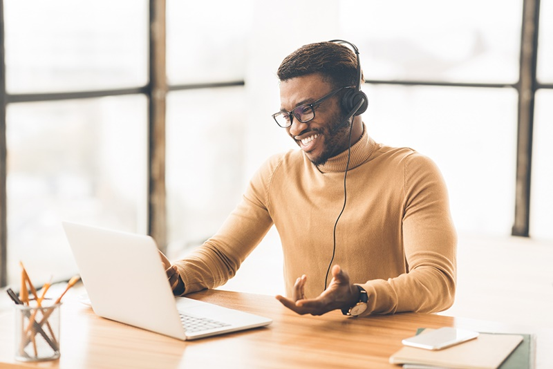 Call Center Service. Smiling black customer support agent talking with client. Copy space