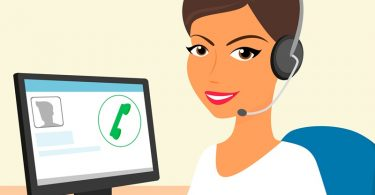Female call centre operator with headset sitting in the office.